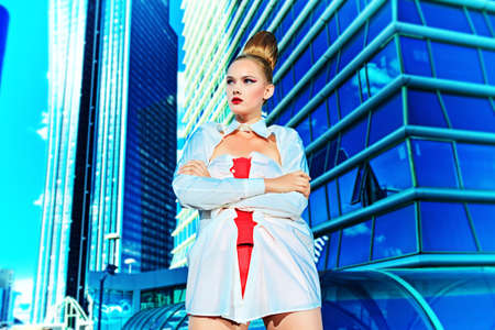 Fashion model posing over big city background  Stock Photo - 16050600