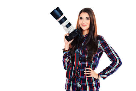 photographic: Pretty young woman taking pictures on the camera. Isolated over white.