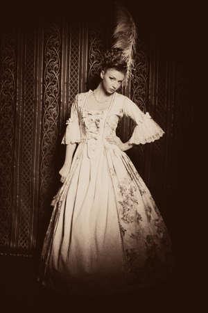 Portrait of the elegant woman in medieval era dress.  photo