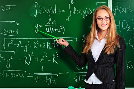 university professor: Portrait of a teacher giving a lecture at a classroom.. Stock Photo
