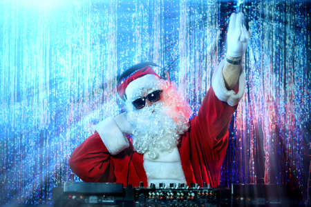 christmas costume: DJ Santa Claus mixing up some Christmas cheer. Disco lights in the background.