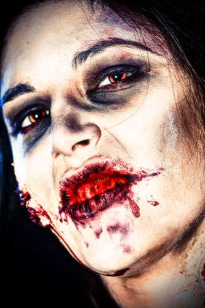 Close-up portrait of a bloodthirsty gnarling zombi. photo