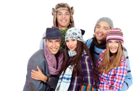 Group of cheerful young people in warm clothes standing together. Friendship. Isolated over white. Stock Photo - 16226049