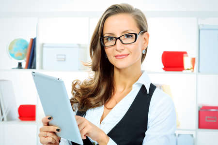 Portrait of a beautiful business woman working with touchpad pc at the office. Stock Photo - 16226063