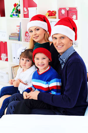 Portrait of a happy family spending Christmas time at home. Stock Photo - 16273210