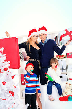 Portrait of a happy family spending Christmas time at home. Stock Photo - 16273189