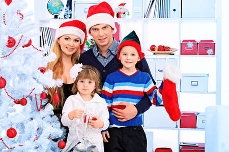 Portrait of a happy family spending Christmas time at home. Stock Photo - 16273215