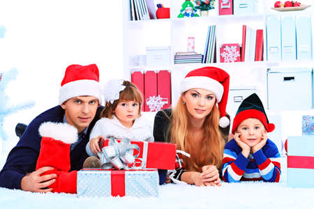 Portrait of a happy family spending Christmas time at home. Stock Photo - 16273185