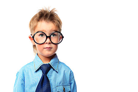 primary education: Portrait of a serious little boy in spectacles and suit. Isolated over white background. Stock Photo
