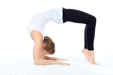 yoga girl: Slender young woman doing yoga exercise. Isolated over white background.
