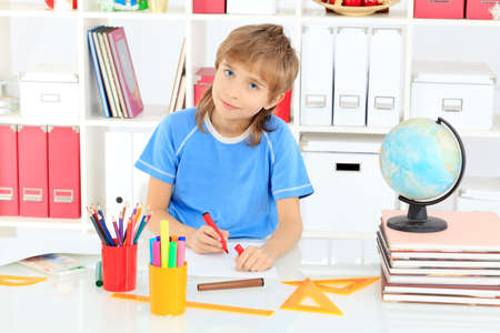 A boy doing his lessons at home. Stock Photo - 16447511