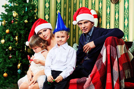 Portrait of a happy family spending Christmas time at home. Stock Photo - 16447542