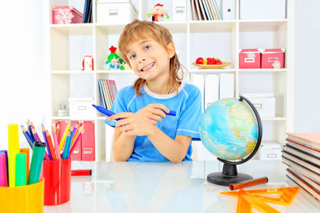 A boy doing his lessons at home. Stock Photo - 16447471