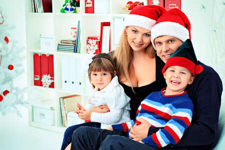 Portrait of a happy family spending Christmas time at home. Stock Photo - 16447509