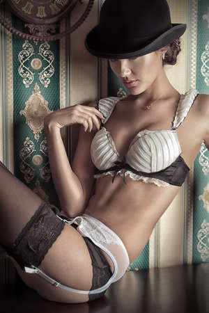Portrait of beautiful young woman in lingerie over vintage background. Stock Photo - 16447533