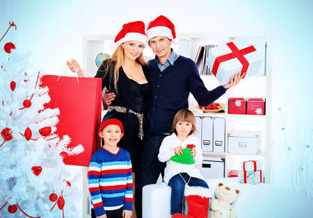 Portrait of a happy family spending Christmas time at home. Stock Photo - 16447492