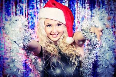 disco girls: Pretty teenage girl in Christmas clothes on a party. Disco lights in the background. Stock Photo