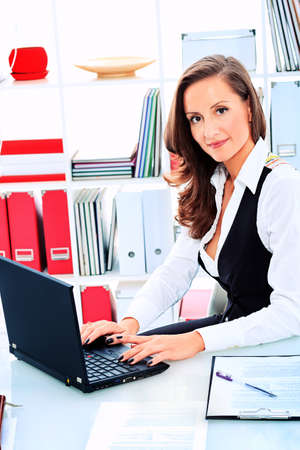 Modern business woman is working at the office. photo