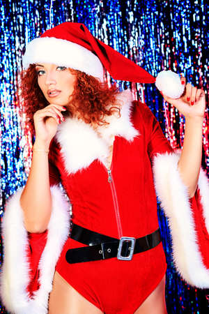 Attractive young woman in Christmas clothes on a party. Disco lights in the background. Stock Photo - 16469881