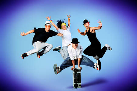 Group of modern dancers dancing hip-hop at studio. Stock Photo