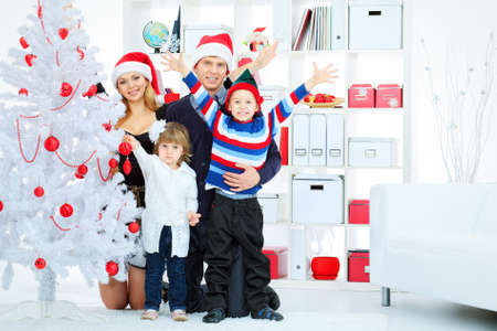Portrait of a happy family spending Christmas time at home. Stock Photo - 16548739