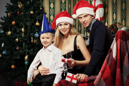 Portrait of a happy family spending Christmas time at home. Stock Photo - 16548742
