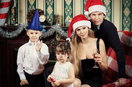 Portrait of a happy family spending Christmas time at home. Stock Photo - 16548740