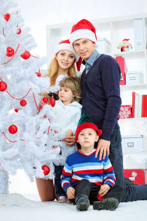 Portrait of a happy family spending Christmas time at home. Stock Photo - 16548743