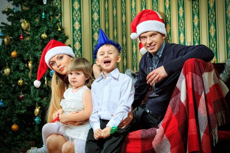 Portrait of a happy family spending Christmas time at home. Stock Photo - 16548744