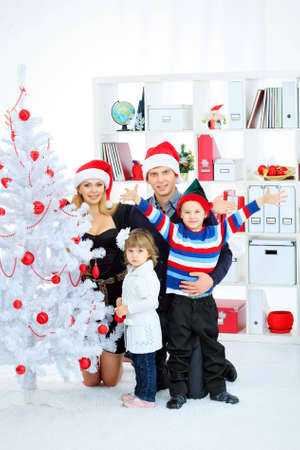 Portrait of a happy family spending Christmas time at home. Stock Photo - 16494857
