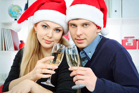 Happy young couple celebrating Christmas near the Christmas tree at home. Stock Photo - 16494866