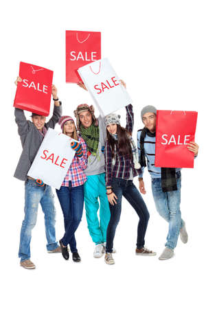 crazy woman: Group of cheerful young people with shopping bags  Isolated over white background