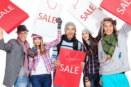 gente loca: Grupo de alegres jóvenes con bolsas de compras aisladas sobre fondo blanco Foto de archivo