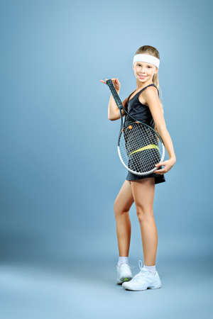 Portrait of a girl tennis player holding tennis racket  Studio shot Stock Photo - 16577602