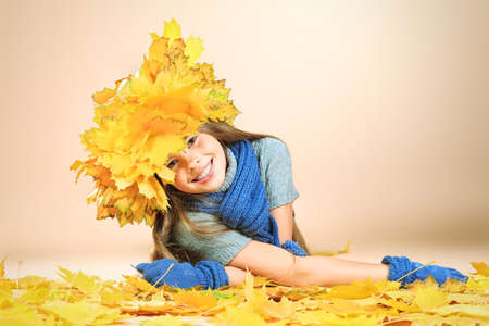 Portrait of a smiling girl in autumn clothes and a hat of maple leaves Stock Photo - 16577607