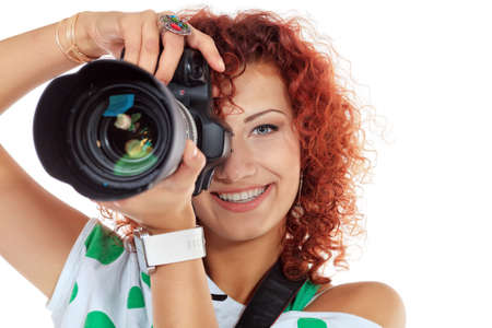 Pretty young woman taking pictures on the camera  Isolated over white