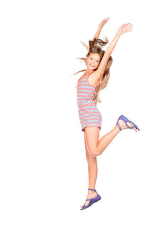schoolgirls: Cute girl jumping for joy  Isolated over white  Stock Photo