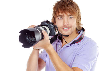 Handsome young man taking pictures on the camera  Isolated over white  photo