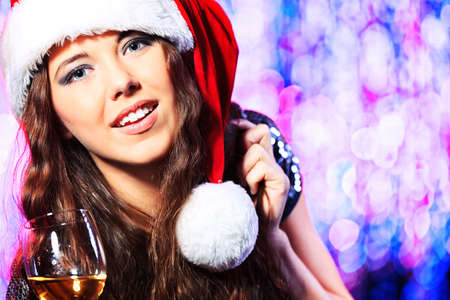 Pretty teenage girl in Christmas clothes on a party. Disco lights in the background. Stock Photo - 16521602