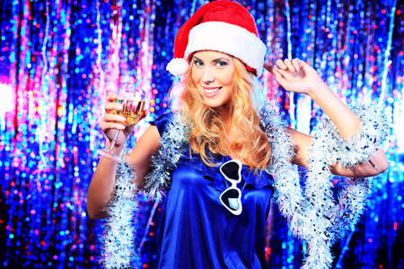 Pretty teenage girl in Christmas clothes on a party. Disco lights in the background. Stock Photo - 16616151