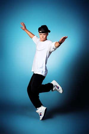 sportive: Trendy young man dancing hip-hop at studio.