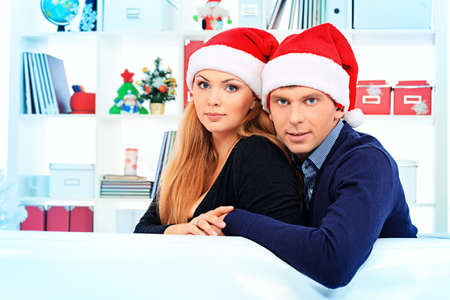 Happy young couple celebrating Christmas near the Christmas tree at home. Stock Photo - 16586493