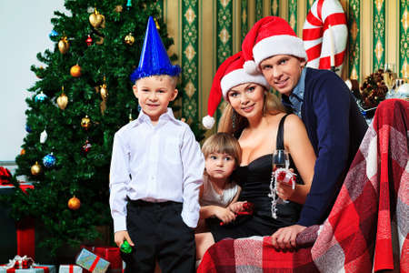 Portrait of a happy family spending Christmas time at home. Stock Photo - 16586492