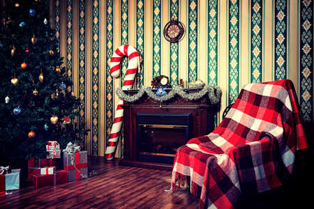 Christmas home decoration with tree, gifts and fireplace. Stock Photo - 16586536