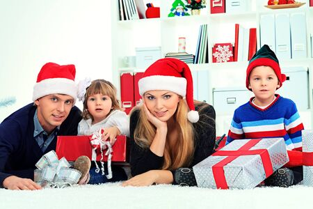 Portrait of a happy family spending Christmas time at home. Stock Photo - 16586488