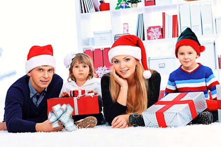 Portrait of a happy family spending Christmas time at home. Stock Photo - 16586485