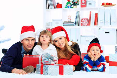 Portrait of a happy family spending Christmas time at home. Stock Photo - 16586495