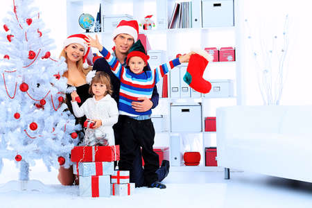 Portrait of a happy family spending Christmas time at home. Stock Photo - 16586501