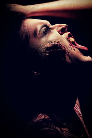 bloodthirsty: Close-up portrait of a bloodthirsty gnarling zombi.