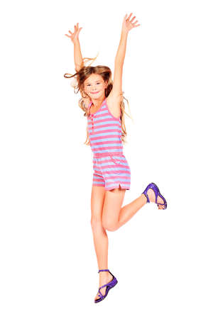Cute girl jumping for joy. Isolated over white. Stock Photo - 16606642